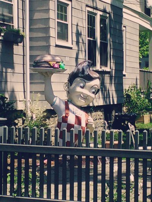 bob's big boy statue, huge, in a tiny yard.