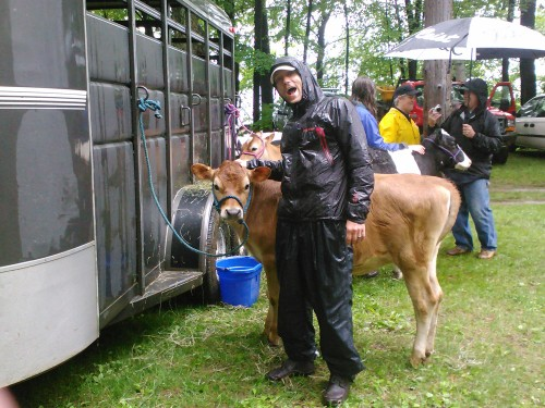Dan poses with a heifer in the rain