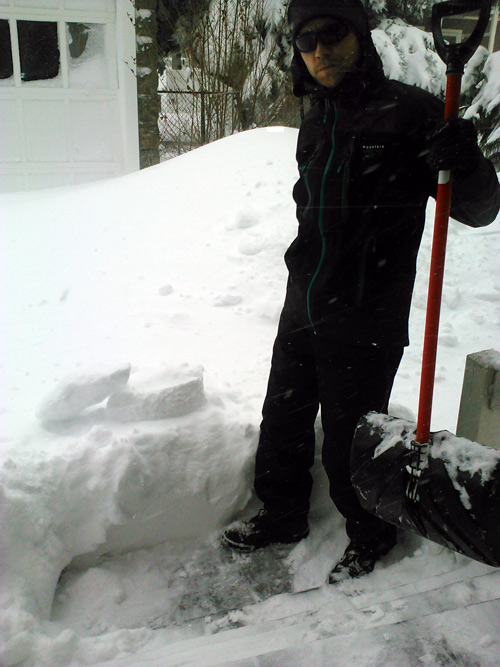 photo of dan with knee high snow and 4ft snow drift.