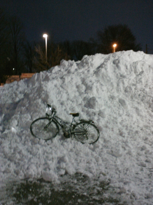 bicycle in a ton of snow.